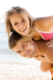 Beautiful couple having fun on the seaside Stock Images