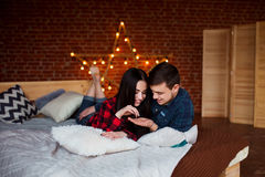 Beautiful couple having fun, smiling and hugging at home. Young man and woman enjoy spending time together. Royalty Free Stock Photos