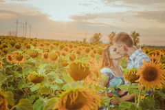Beautiful couple having fun in sunflowers fields Royalty Free Stock Photos
