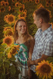 Beautiful couple having fun in sunflowers fields Stock Photo