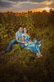 Beautiful couple having fun in sunflowers fields Royalty Free Stock Photo