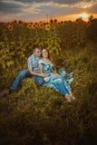 Beautiful couple having fun in sunflowers fields Royalty Free Stock Photo