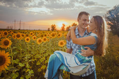 Beautiful couple having fun in sunflowers fields Stock Photography