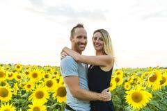Beautiful couple having fun in sunflowers fields Stock Photography