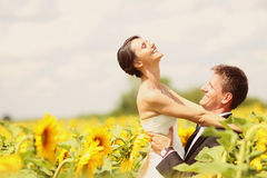 Beautiful couple having fun in sunflowers Royalty Free Stock Photos