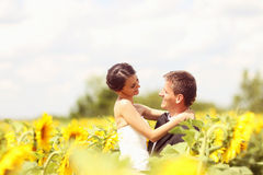 Beautiful couple having fun in sunflowers Stock Images