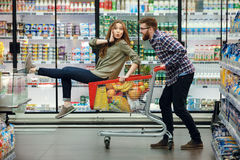 Free Beautiful Couple Having Fun While Choosing Food In The Supermarket Stock Image - 92472621