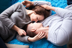 Beautiful couple having great time and hugging at home. Top view. Royalty Free Stock Photography