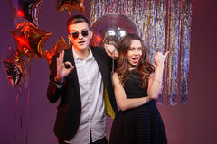 Beautiful couple having party and showing thumbs up Royalty Free Stock Photo
