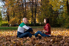 Beautiful Couple In The Heap Of Leaves Royalty Free Stock Photo