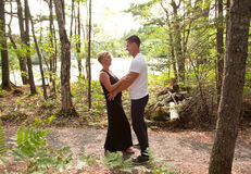 A beautiful couple hold each other outdoors Stock Photos