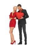Beautiful couple holding big heart Royalty Free Stock Photo