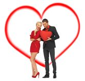 Beautiful couple holding big heart Royalty Free Stock Images