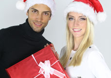 Beautiful Couple holding a Christmas present Royalty Free Stock Photo