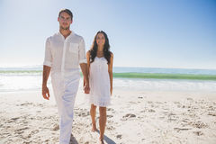 Beautiful couple holding hands and walking towards camera Royalty Free Stock Images