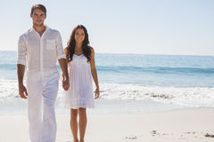Beautiful couple holding hands and walking towards camera Stock Photography