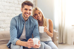 Beautiful couple at home Stock Images