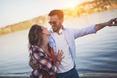 Beautiful couple hugging and dating on beach. At sunset Royalty Free Stock Photo