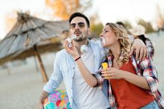 Beautiful couple hugging and dating on beach. At sunset royalty free stock images