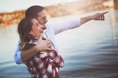 Beautiful couple hugging and dating on beach Royalty Free Stock Image