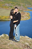 Beautiful couple hugging and kissing  outdoor. Beautiful couple hugging and laughing on a lake background.Marriage proposal Stock Images