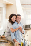 Beautiful couple hugging in the kitchen Stock Image