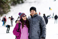 Beautiful couple hugging and laughing outdoor on a ski slope Stock Images