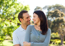Beautiful couple hugging in the park Stock Photo