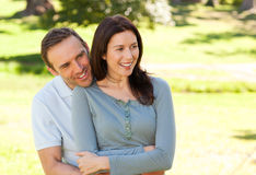 Beautiful couple hugging in the park Royalty Free Stock Photos
