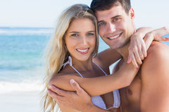 Beautiful couple hugging and smiling at camera Royalty Free Stock Photos