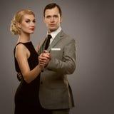 Beautiful couple isolated on grey Stock Images