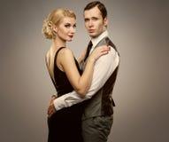 Beautiful couple isolated on grey Royalty Free Stock Photos