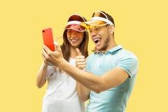 Beautiful couple isolated on yellow studio background stock photography