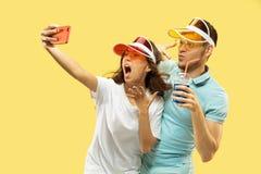 Beautiful couple isolated on yellow studio background royalty free stock photos