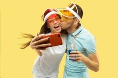 Beautiful couple isolated on yellow studio background royalty free stock image