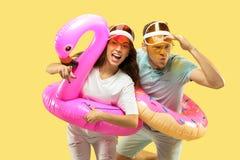 Beautiful couple isolated on yellow studio background stock photo