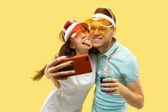 Beautiful couple isolated on yellow studio background royalty free stock photography