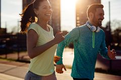 Beautiful couple jogging in nature Royalty Free Stock Photography