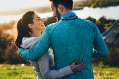 Beautiful couple jogging in nature Stock Photos