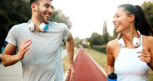 Beautiful couple jogging in nature. Living healthy Stock Photos