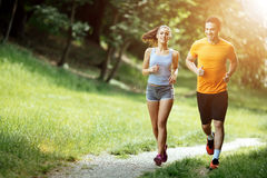 Beautiful couple jogging in nature. Living healthy Stock Photo