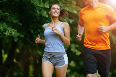 Beautiful couple jogging in nature Stock Image