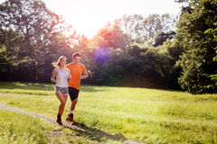 Beautiful couple jogging in nature Stock Photography