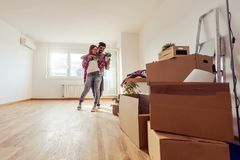 Young couple just moved into new empty apartment unpacking and cleaning - relocation stock images
