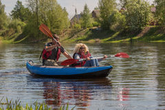 Beautiful couple is kayaking on the river Stock Photos