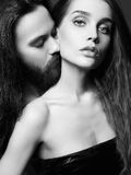 Beautiful couple kiss. Sexy women and handsome man.black and white portrait of lovely boy and girl royalty free stock photography
