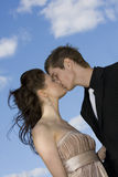 Beautiful couple kissing. Young beautiful couple kissing on sky background Stock Photos