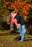 Beautiful couple kissing in autumn park Royalty Free Stock Photos
