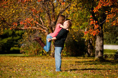 Beautiful couple kissing in autumn park Royalty Free Stock Images