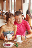 Beautiful couple kissing at cafe Royalty Free Stock Images